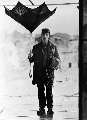 Buster Keaton Holding Broken Umbrella in Steamboat Bill, Jr.
