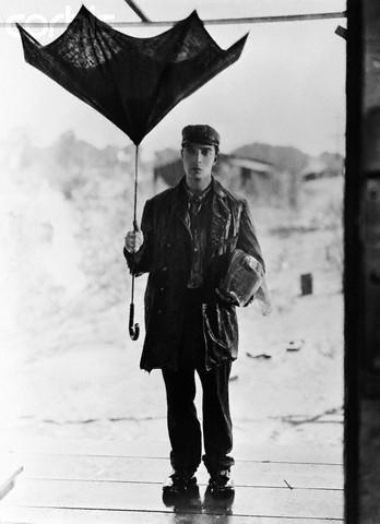 Buster Keaton Holding Broken Umbrella in Steamboat Bill, Jr.